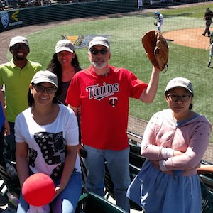Popper and students at ballgame