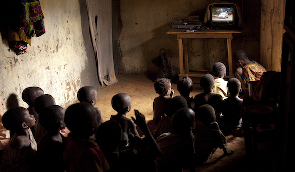 Children in Benin watch television, photo by Arne Hoel, World Bank/CC BY-NC-ND 2.0