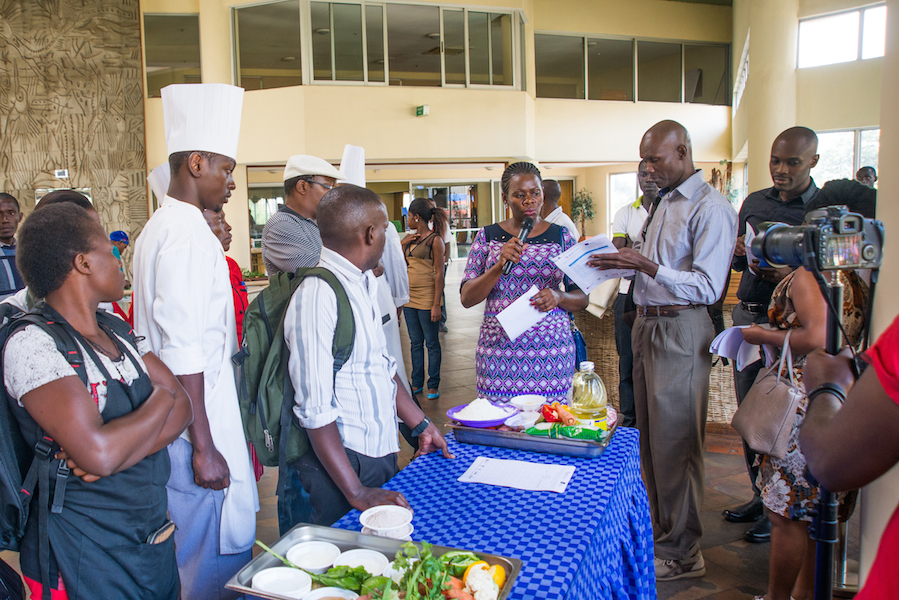 Two of the judges, Sarah Sakwa and Chef Robert Mulandi, share instructions with the participants