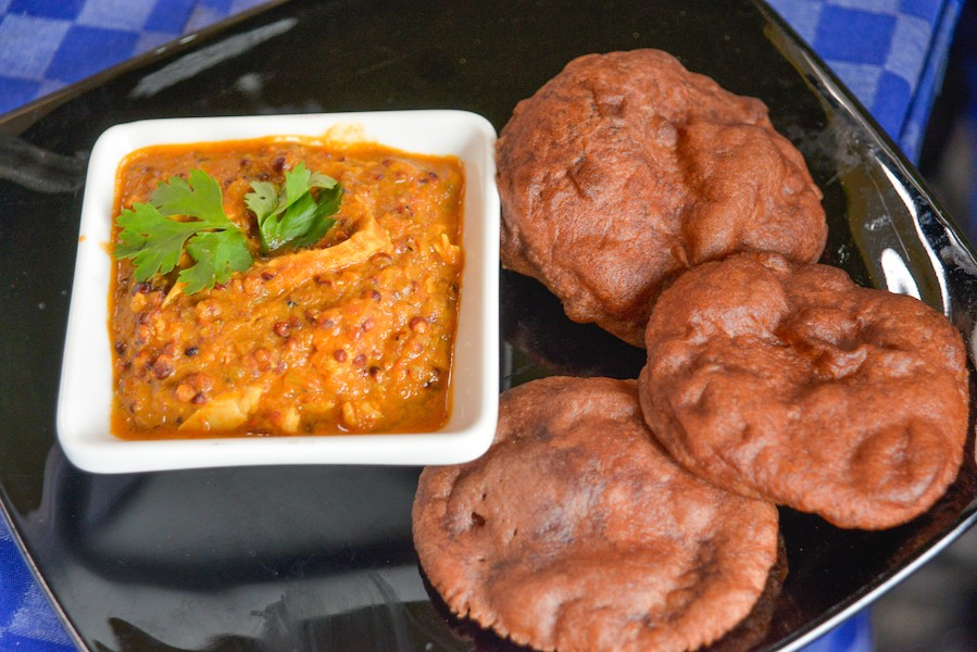 Sorghum and chicken curry with millet bhatura by Chef Tobias Okumu
